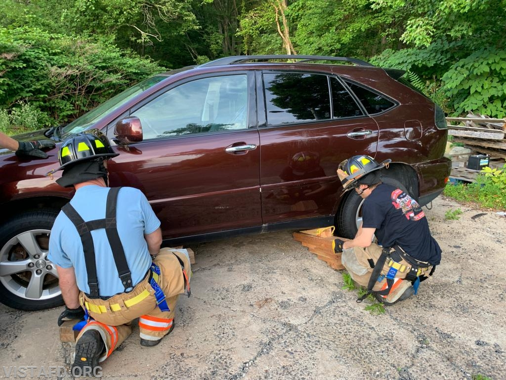 Vista Firefighters practicing how to use cribbing on a car