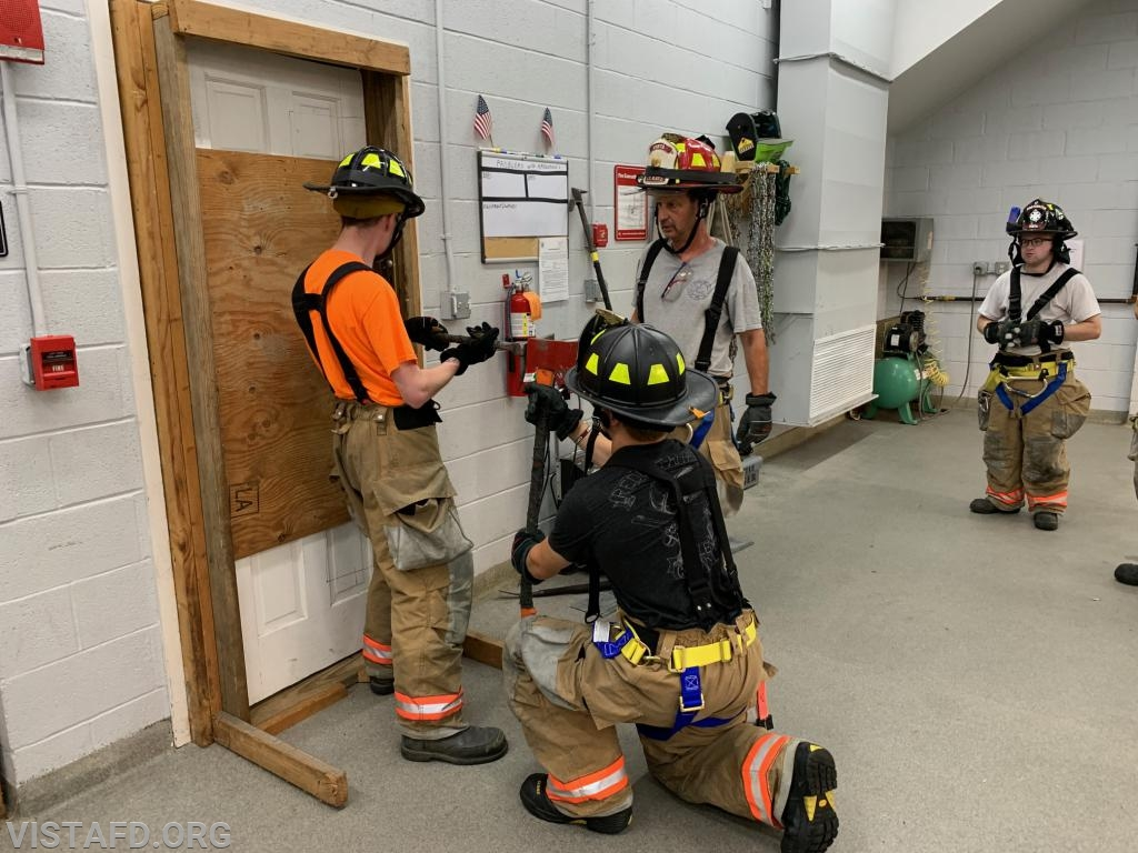 Probationary Firefighter Arlington Trenck and Firefighter Finn Brannan conducting forcible entry operations