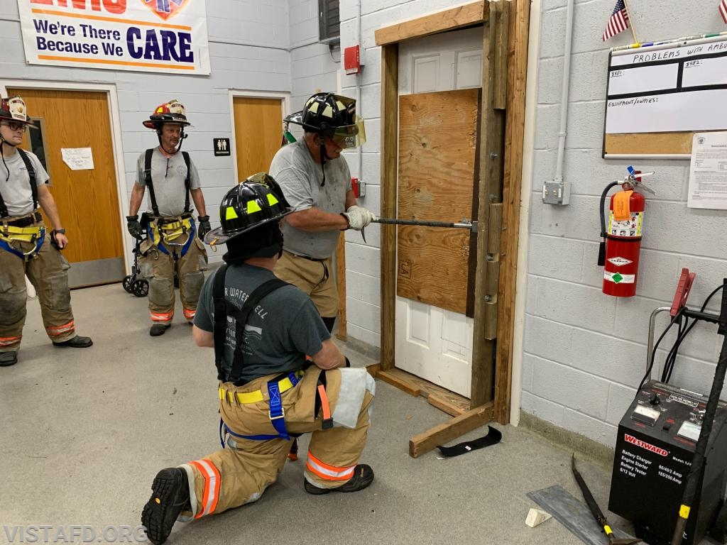 Firefighter Ron Egloff and Firefighter Steven Woodstead conducting forcible entry operations