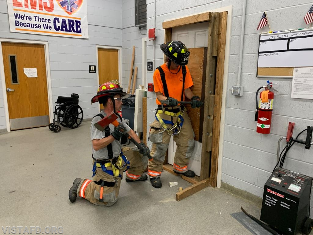 Foreman Patrick Healy and Lt. Phil Katz conducting forcible entry operations