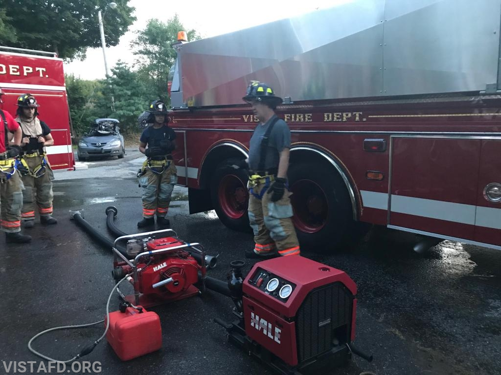 Firefighter Steven Woodstead going over to how operate the portable pumps