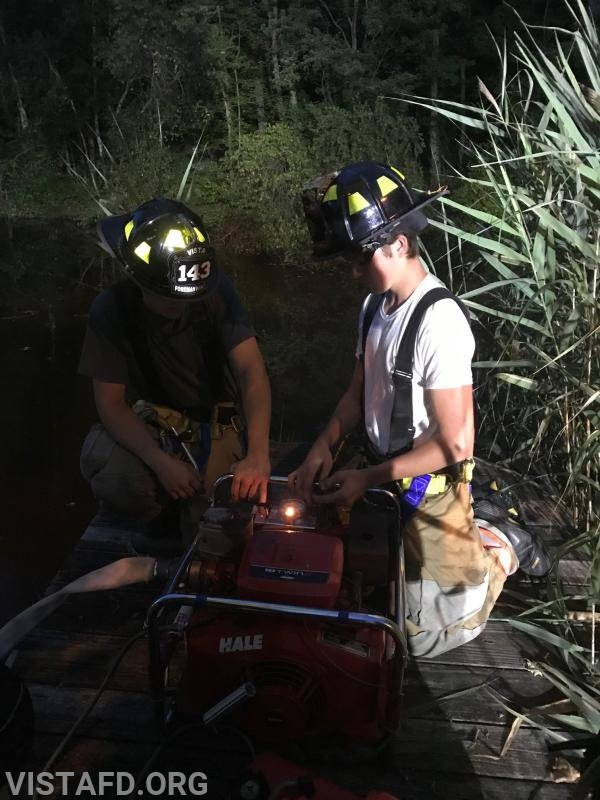 Vista Firefighters operating the portable pumps