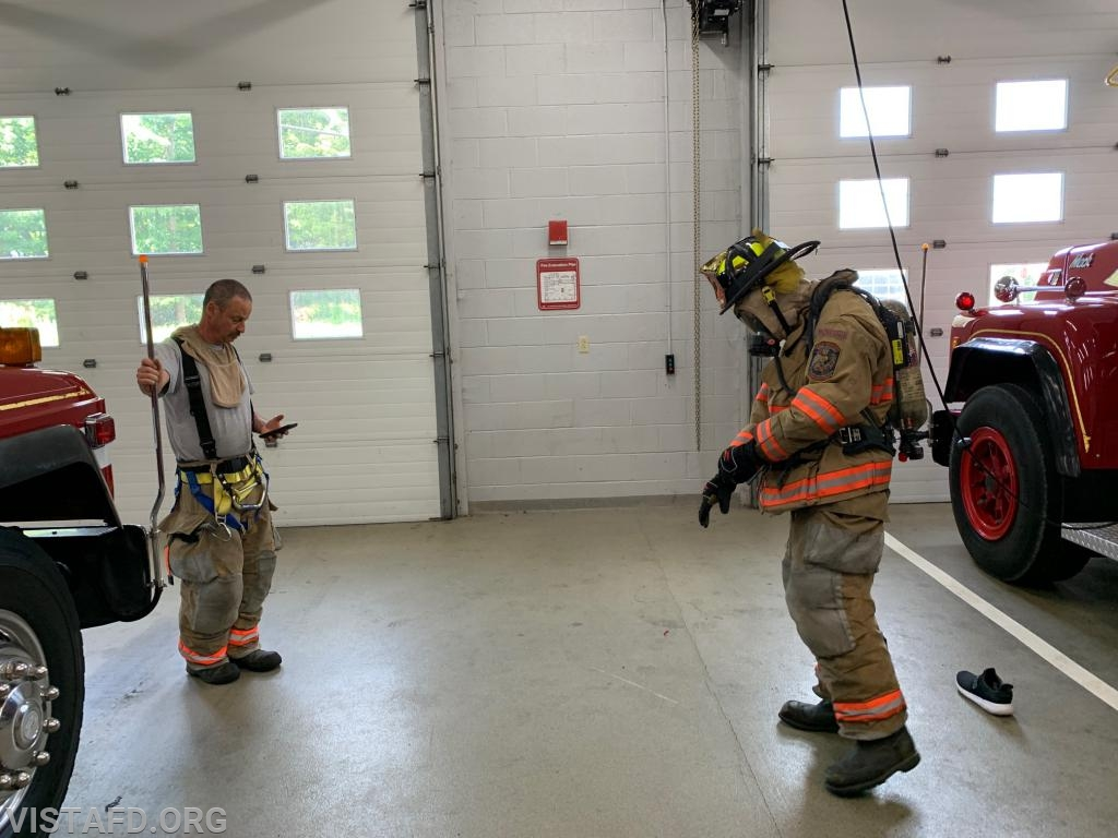 Probationary Firefighter Arlington Trenck going through the 2-minute drill