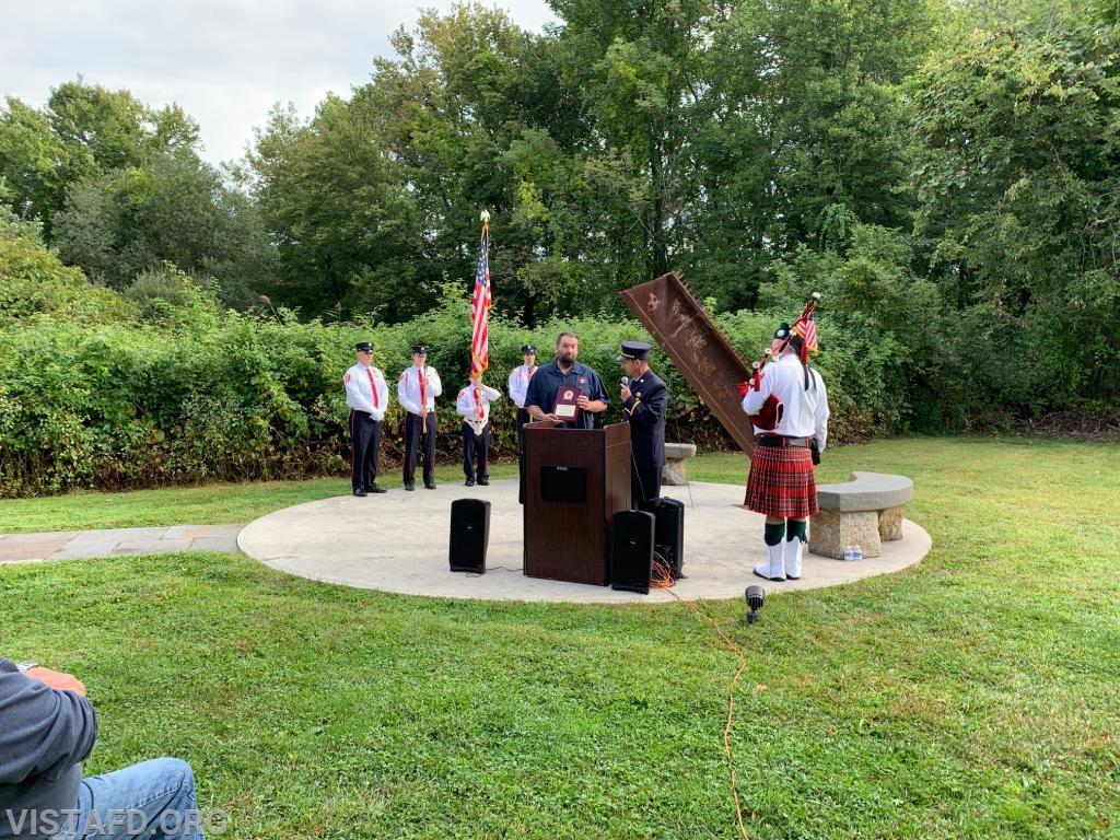 Vista Fire Department President Phil Katz presenting an award honoring Zachary Jackson