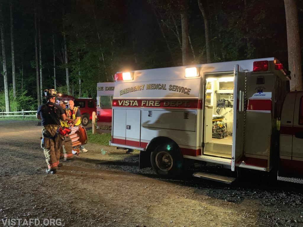 "Vista Fire Department personnel retrieving equipment for the ""Lost Person Search"" drill"