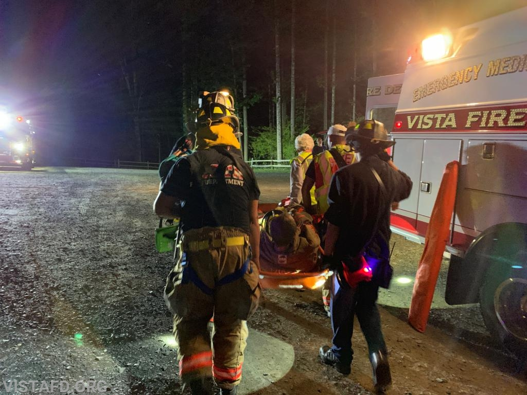 """Vista Fire Department personnel extricating the patient during the """"Lost Person Search"""" drill"""