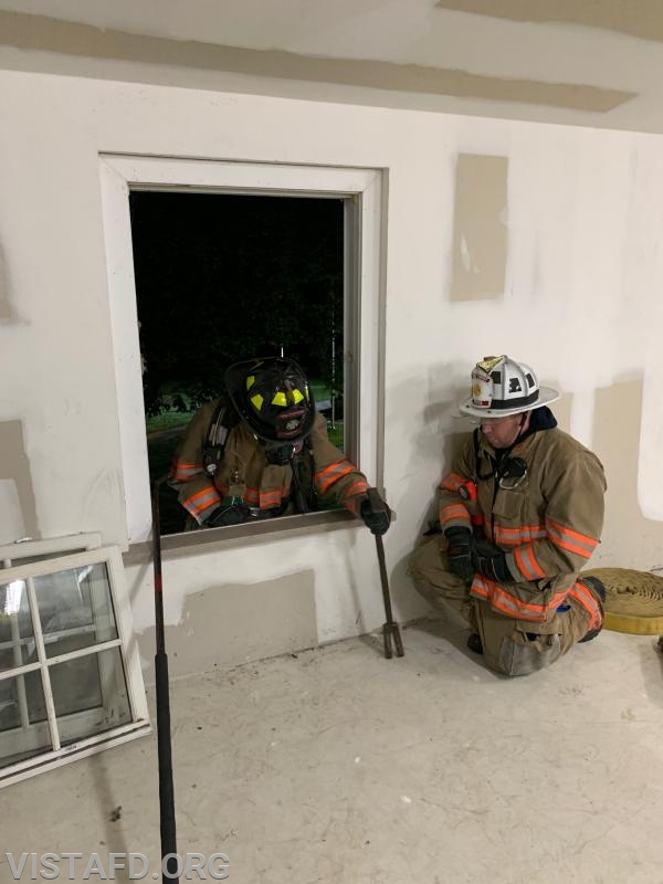 Vista Firefighters sounding the floor during V.E.I.S. operations