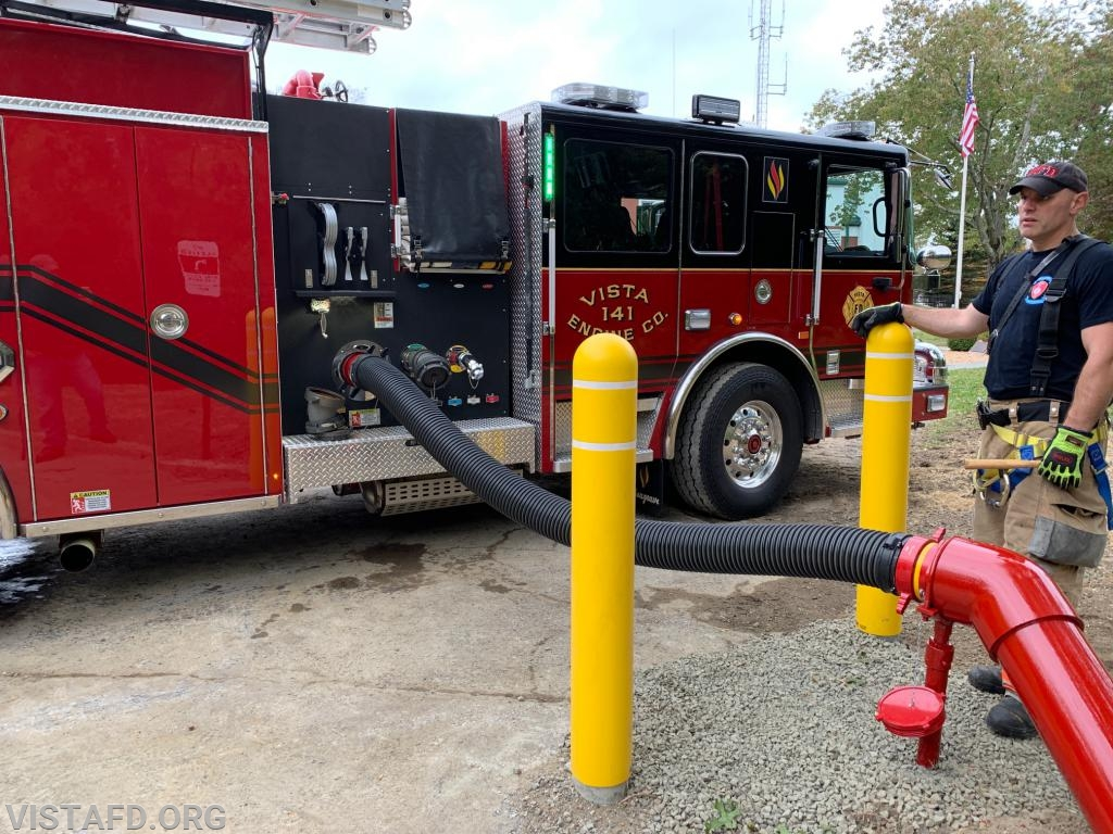 Lead Foreman Baiocco hooking E-141 up to the Vista Firehouse dry hydrant