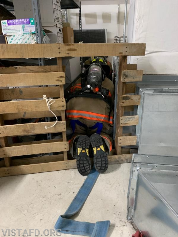 Vista Firefighters going through the SCBA mask confidence course