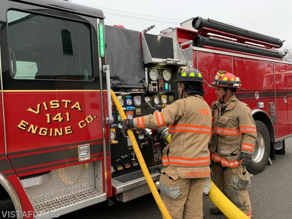 """Lt. Phil Katz going over how to pump Engine 141 with Foreman Dan Castelhano during """"Motor Pump Operators and Firefighter Skills Class"""""""