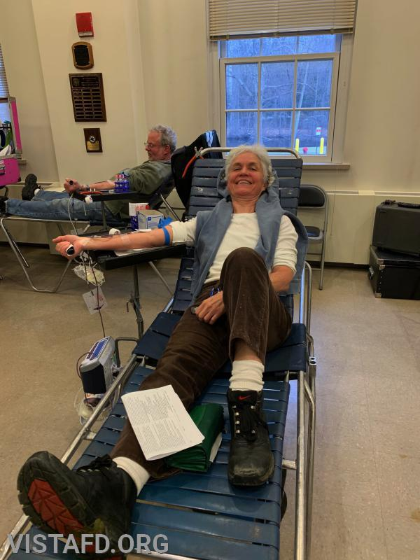 Firefighter Lynda Scott donating blood during our Winter Blood Drive