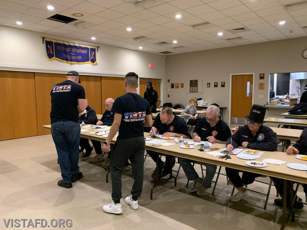 Lead Foreman Marc Baiocco and Firefighter Adam Ferman of Platoon 1 presenting their meal to the cooking competition judges