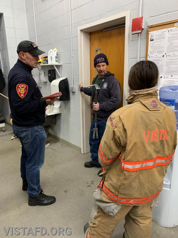 "Lt. Phil Katz and Lead Foreman Marc Baiocco going over how to conduct forcible entry during ""MPO and Firefighter Skills Class"""