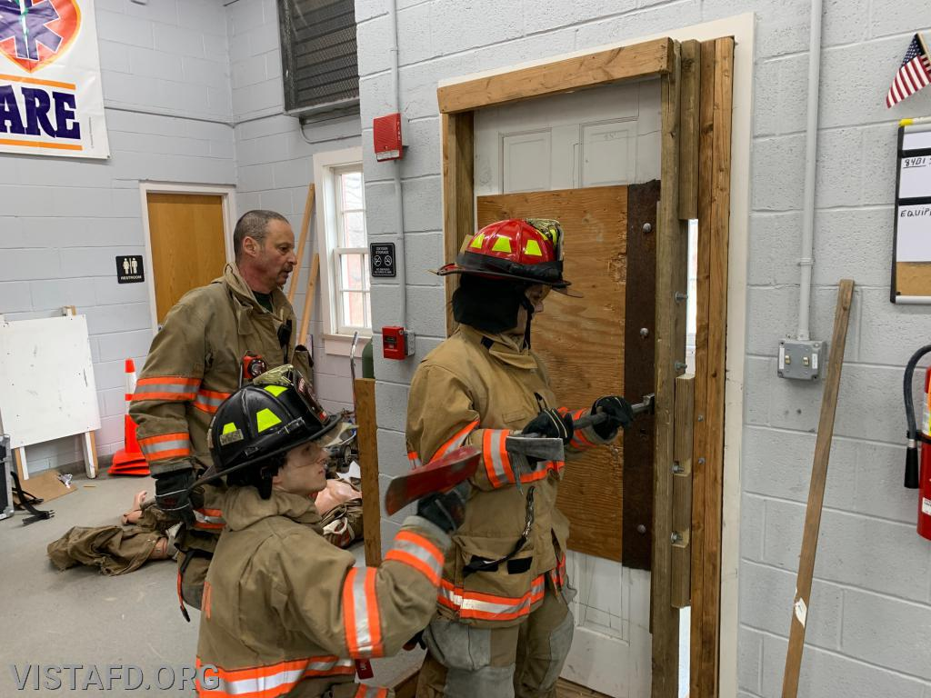 "Probationary FF Kyla Whalen practices Forcible Entry during ""Firefighter Skills Class"""