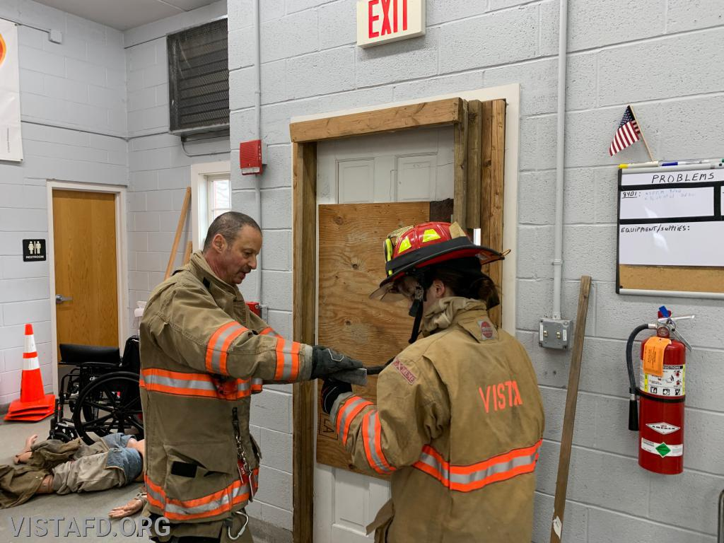 "Lt. Phil Katz going over Forcible Entry with Probationary FF Kyla Whalen during ""Firefighter Skills Class"""