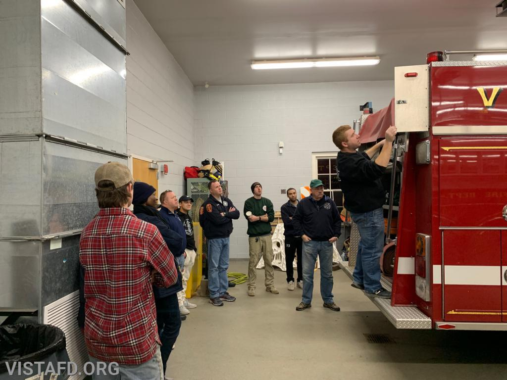 Assistant Chief Mike Peck going over the equipment on Engine 142