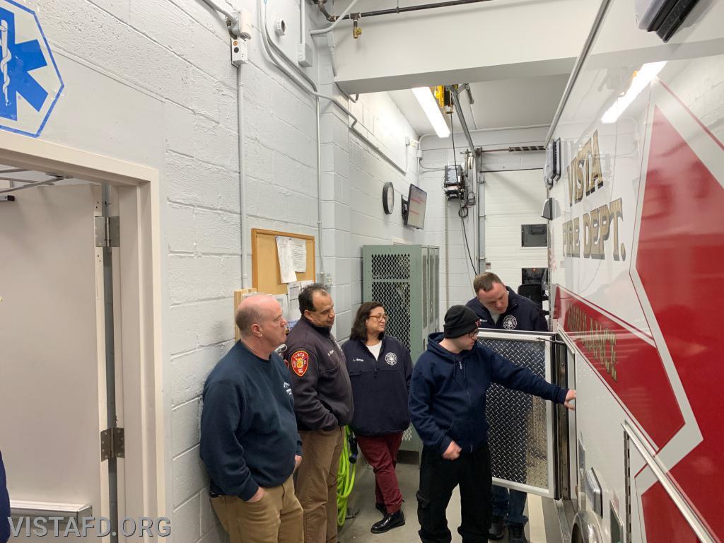 FF/EMT Ryan Ruggiero going over the equipment on Ambulance 84B1