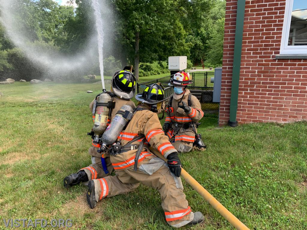 "Vista Firefighters practicing how to operate an 1-3/4"" hose line during ""Firefighter Skills Class"""