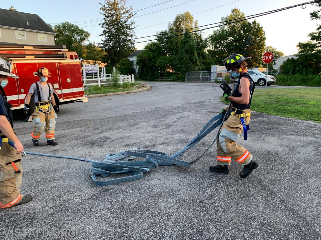 Firefighter Ethan Haberny practicing hose line advancement