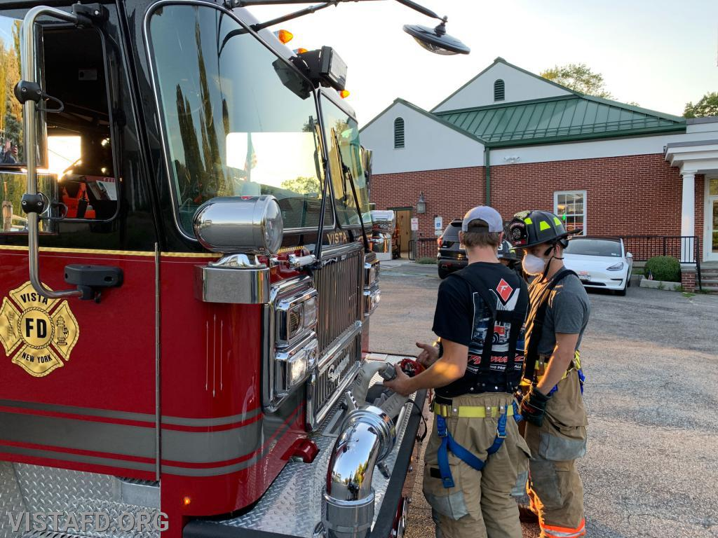Foreman Patrick Healy going over how to stretch the front bumper line off of Engine 141
