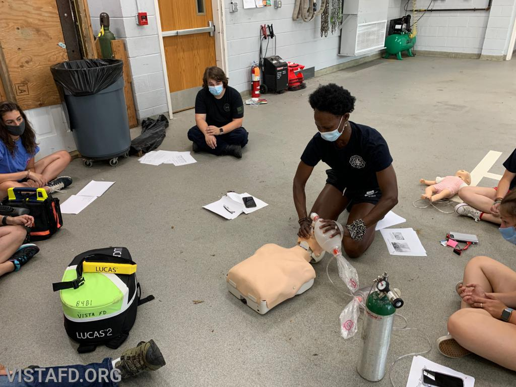 Vista EMS personnel going over how to conduct CPR during a cardiac arrest call