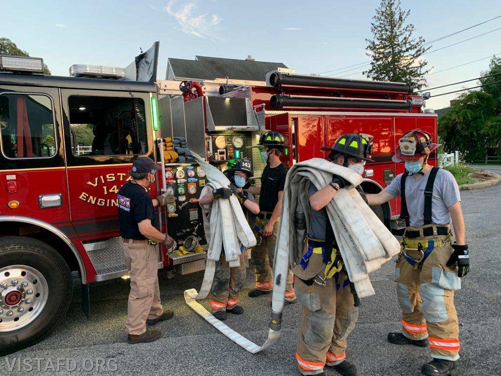 Vista Firefighters practicing hose line advancement