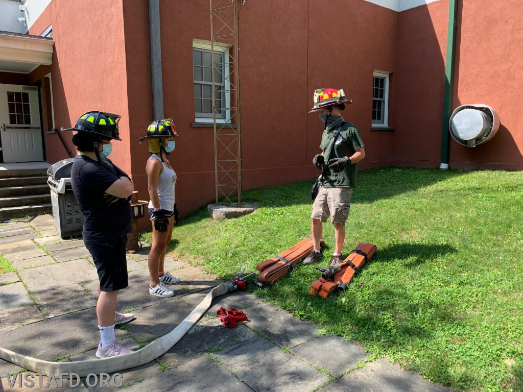 "Capt. Phil Katz going over the extended hose line stretch during ""Firefighter Skills Class"""