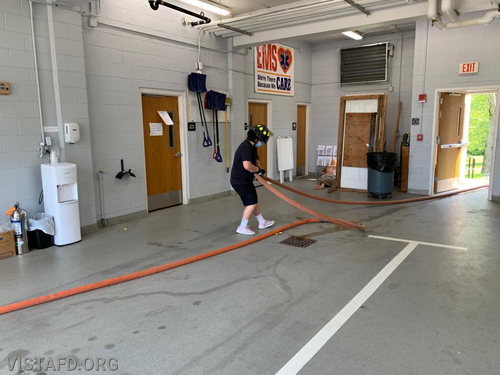 FF/EMT Emily Kaplan performing an extended hose line stretch