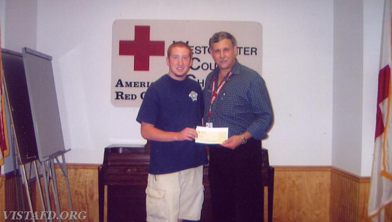 Chief Jeff Peck giving the Westchester County Red Cross a check for over $10,000 from the boot drive we held to help Hurricane Katrina victims