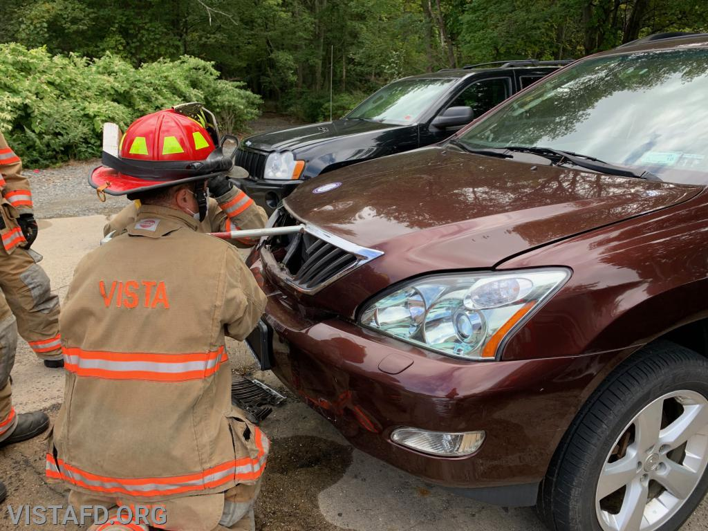 Capt. Phil Katz going over how to open the hood of a car during an extrication