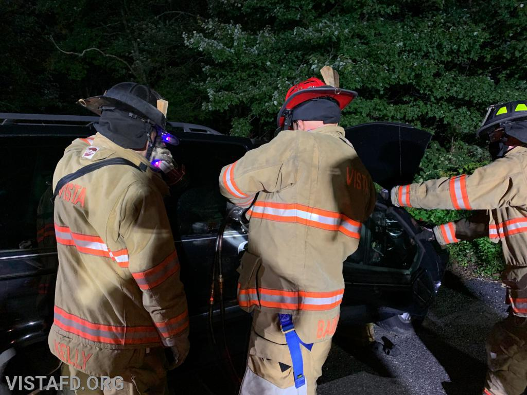 Lieutenant Marc Baiocco practicing how to use the extrication tools during a motor vehicle accident