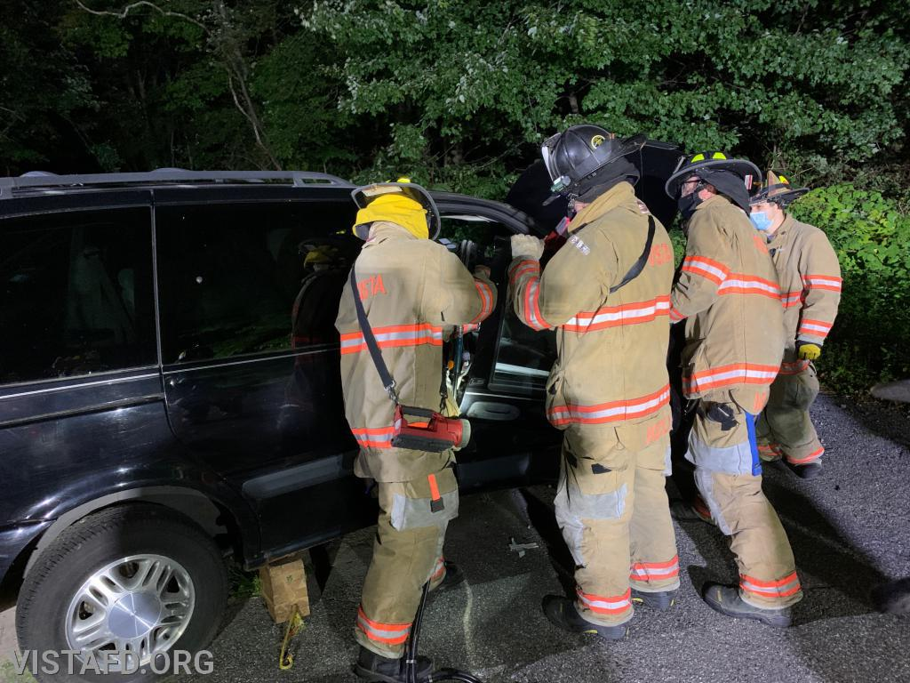 Firefighter Lance Phillips practicing how to use the extrication tools during a motor vehicle accident