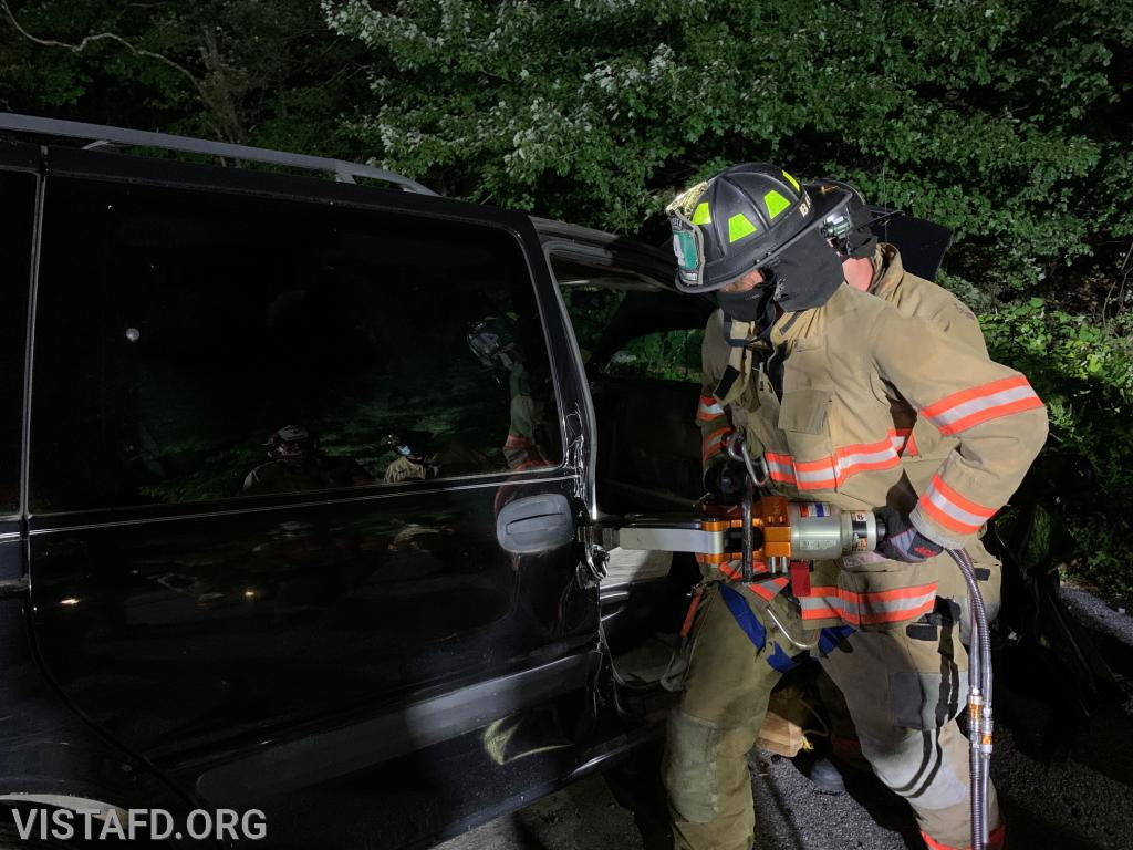 Lead Foreman Adam Bartley practicing how to use the spreaders during an extrication