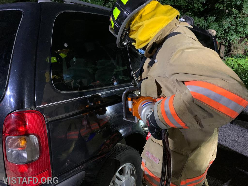 Firefighter Lance Phillips practicing how to use the spreaders during an extrication