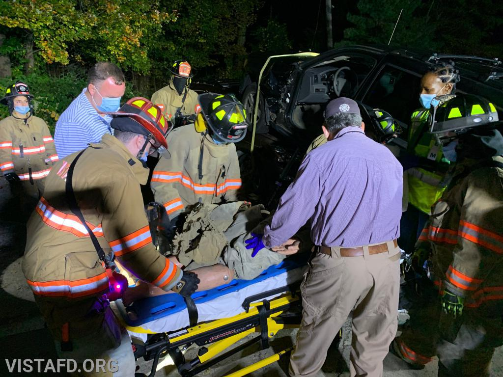 Vista Firefighters & EMS personnel removing the patient from the vehicle
