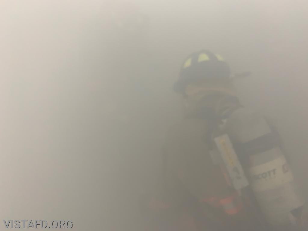 Vista Firefighters conducting search & rescue operations in a smoke filled room