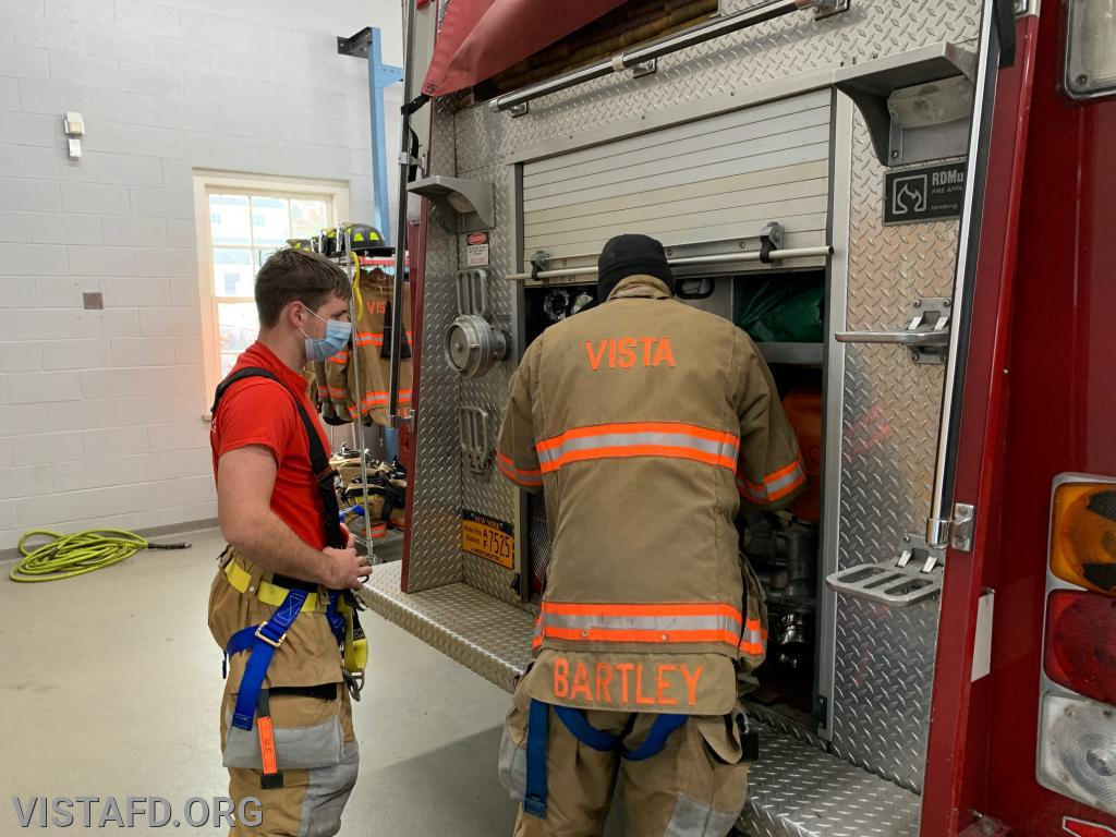Lead Foreman Bartley going over Engine 142 with Firefighter Patrick Blasco