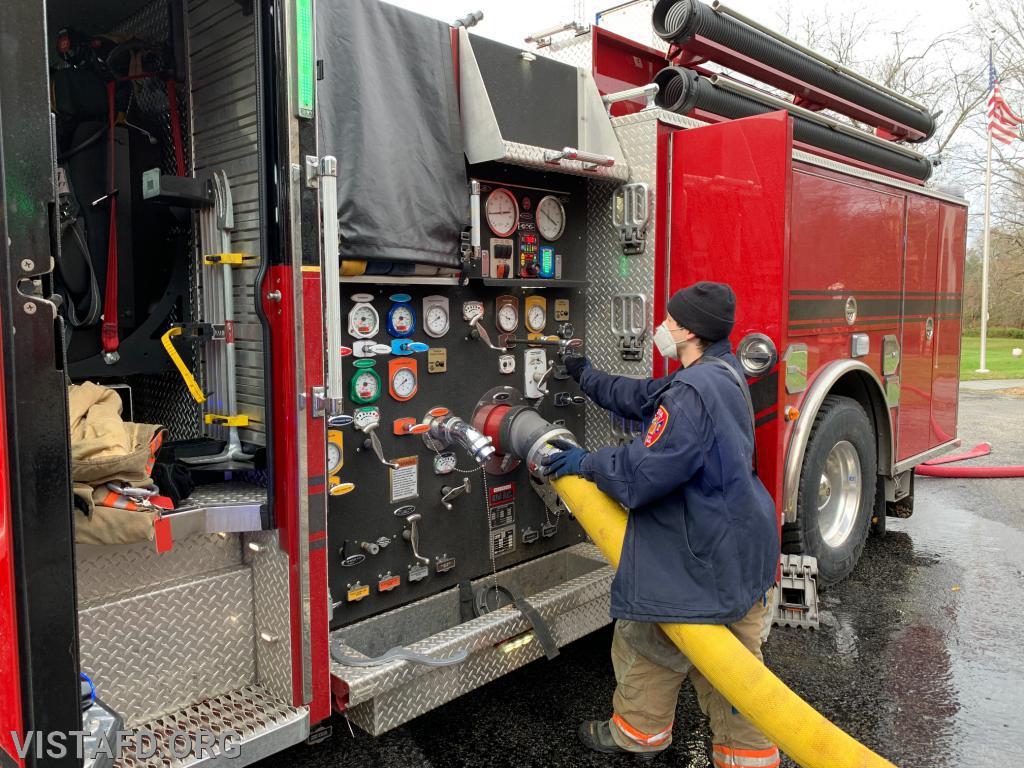 Mutual Responder Dom Mangone operating the Engine 141 pump panel