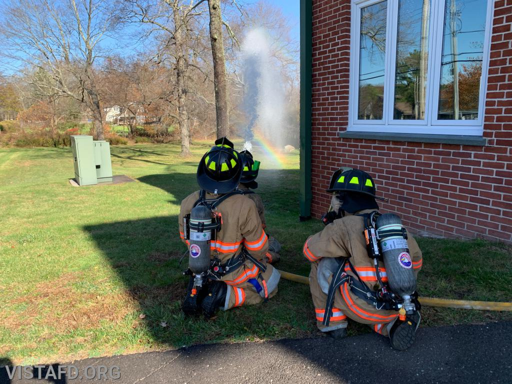"""Vista Firefighters operating the 1-3/4"""" hose line"""
