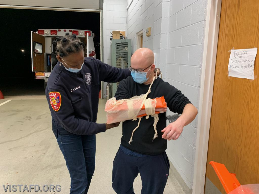 Foreman Ryan Ruggiero and Probationary EMT Candidate Judith Le Gall going over how to splint a patient