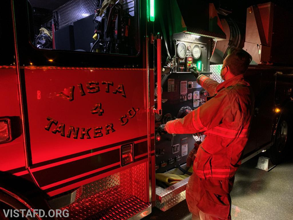 """Lead Foreman Adam Bartley operating the Tanker 4 pump panel during the """"hydrant service"""" drill"""