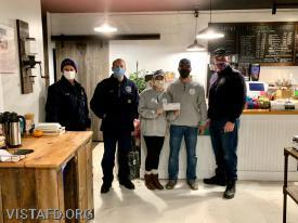 President Phil Katz, Chief Jeff Peck and Vice President Marc Baiocco presenting a check to Erich & Michelle Smith from The Farmer's Grind