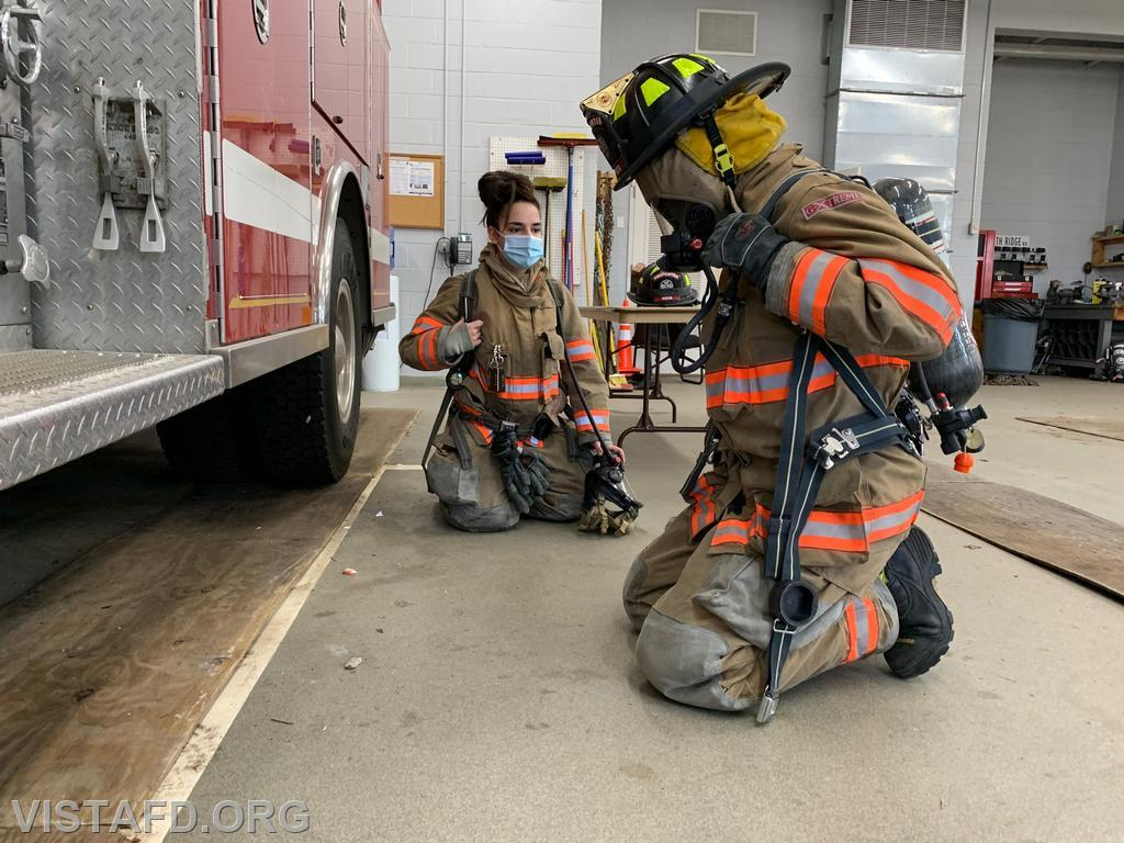 "Firefighter/EMT Isabel Fry practicing SCBA operations during ""Firefighter Skills Class"""