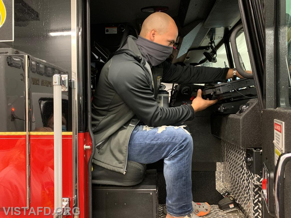 Probationary Firefighter Jose Rosa practicing how to use the new apparatus laptops