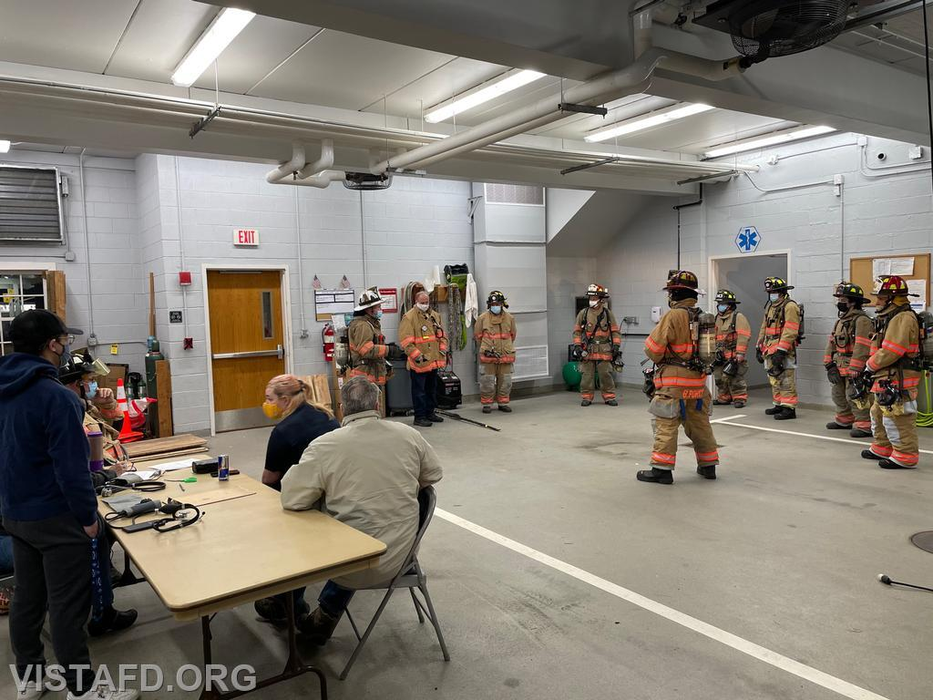 """Assistant Chief Mike Peck going over the """"V.E.I.S. and Rehab Operations"""" drill scenario"""
