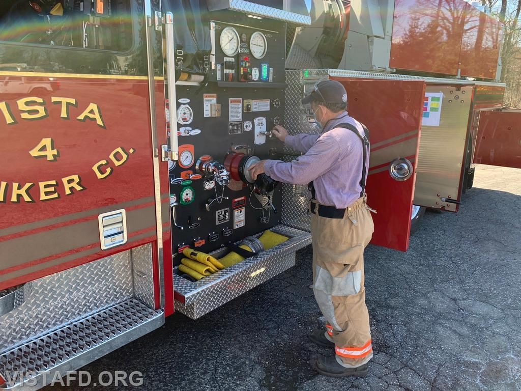 Firefighter Brian Sferra practicing how to operate the Tanker 4 pump panel