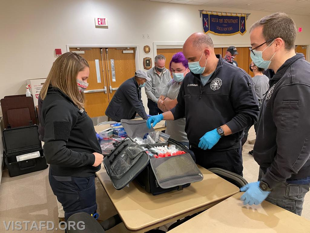 Foreman Elly Hersam, FF/EMT Emily Kaplan, Foreman Dan Castelhano and Captain Brian Porco reviewing our trauma bag