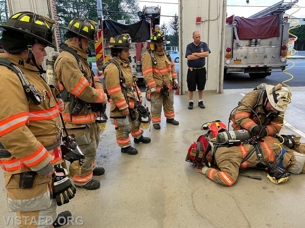Vista Firefighters reviewing how to utilize the RIT pak on a downed Firefighter
