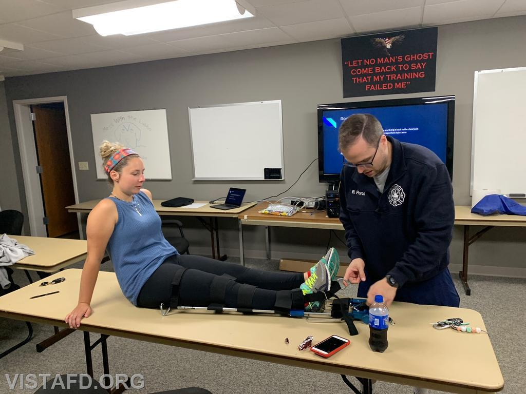Assistant Chief Brian Porco and Foreman Elly Hersam going over how to use the traction splint