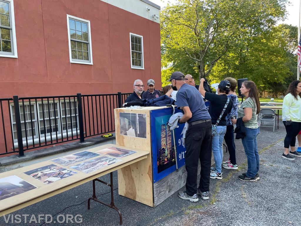 """Members of the community purchasing t-shirts at the """"Tunnel to Towers Foundation"""" Fundraiser"""